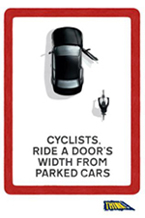 cyclists-ride-a doors-width-from-parked-cars